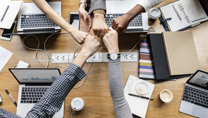 A business team giving Fist Bump in agreement